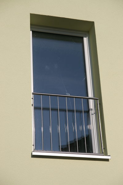 Brushed steel guardrail at one window