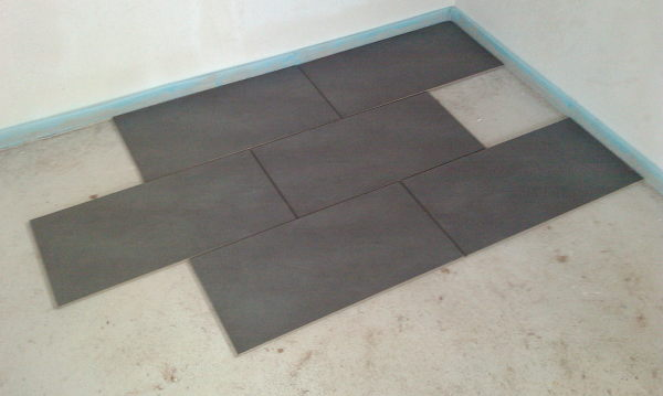 Some floor tiles in the kitchen.