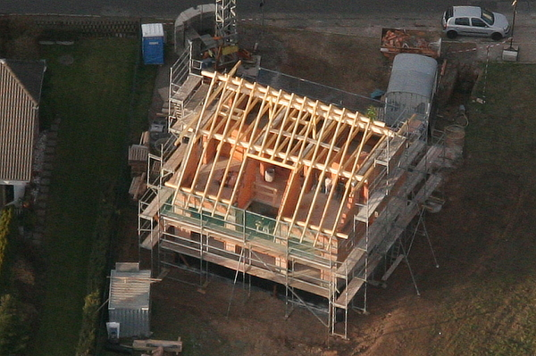 Aerial view of the house with the roof skeleton done.