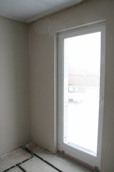 Wall with plaster and window